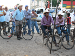 Life continues as usual in the plaza at the Jesuit mission in Yaqui town of Pótam