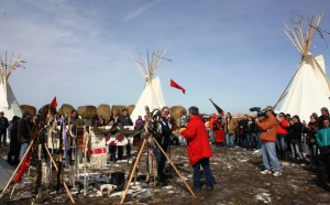 Photo courtesy Shield the People. In Rosebud Sioux tribal jurisdiction, tribal government officials and activists established one of several spirit camps, erecting seven teepees on the pipeline route to represent the Seven Council Fires of the Great Sioux Nation united in warding off the Black Snake through prayer.