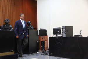 Flores arrives in court in San Salvador