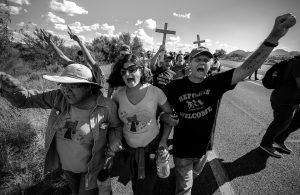 SOA Watch Activists marching toward Border Patrol Checkpoint near Tubac, Arizona, Credit: Steve Pavey