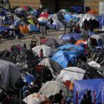 Tent camp of migrants at El Chaparral Port of Entry, Tijuana, Mexico - March 2021